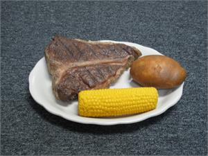 Replica steak dinner with fake potato for plastic foods for display.
