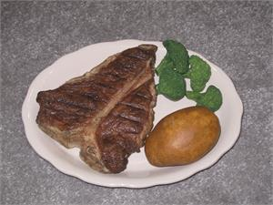Replica steak dinner plate for fake foods display.